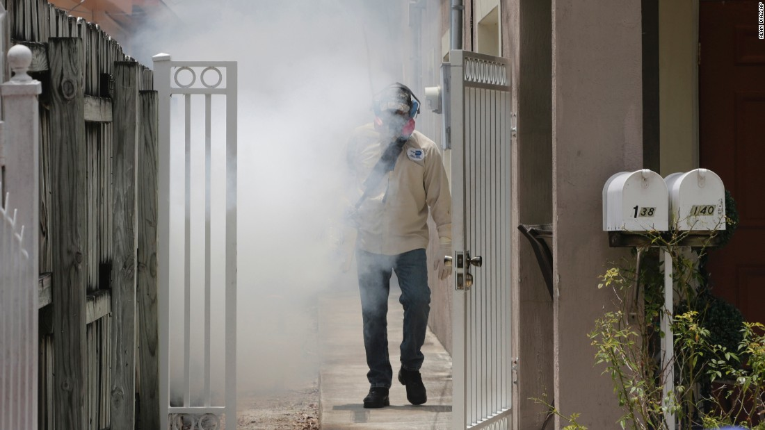 "A mosquito control worker from Miami-Dade County sprays around a home in Miami on Monday, August 1. The Centers for Disease Control and Prevention <a href=""http://www.cnn.com/2016/08/01/health/cdc-miami-florida-zika-travel-warning/"" target=""_blank"">has issued an unprecedented travel warning,</a> advising pregnant women and their partners not to travel to a small community just north of downtown Miami where the Zika virus is actively circulating."