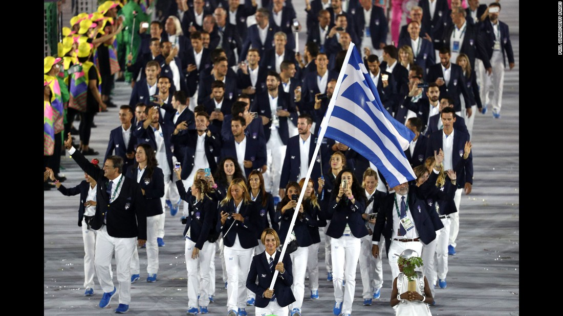 Sailing athlete Sofia Bekatorou leads Greece out.