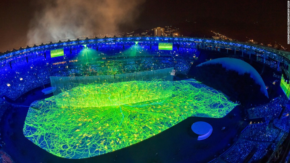 The colorful performances that opened the ceremony included lasers, 3-D projections and a cascade of water enveloping the stage.