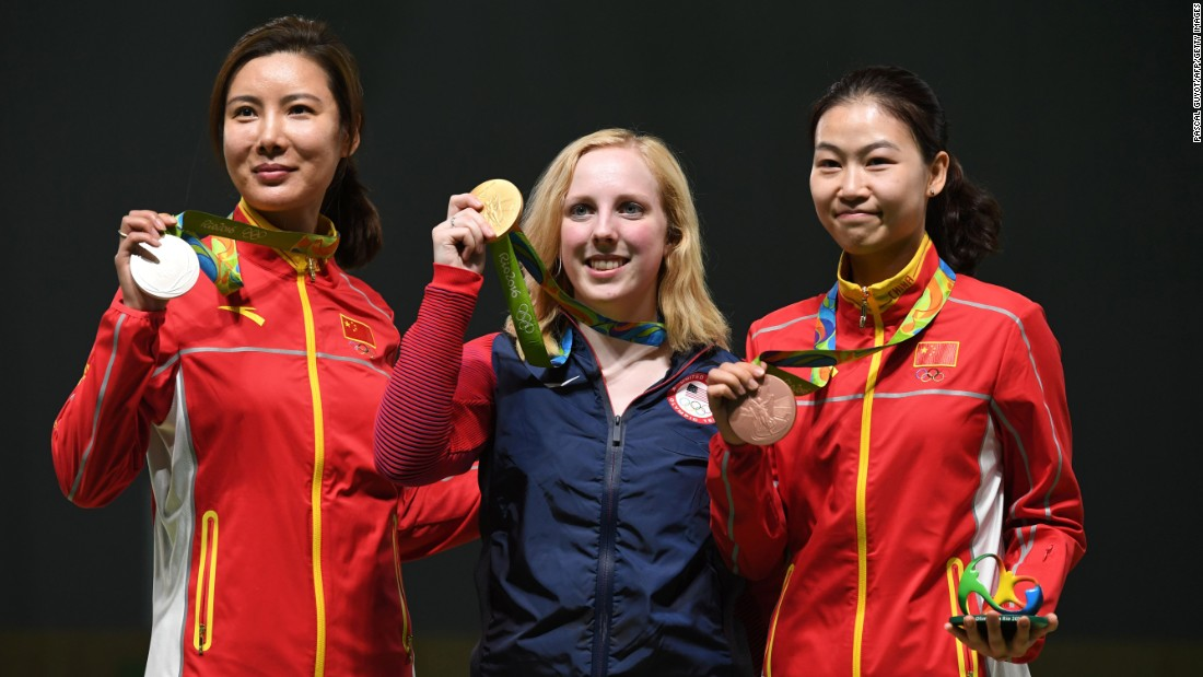 Gold medalist Virginia Thrasher of the U.S., center, poses with China's silver medal winner Du Li, left, and China's bronze medalist Yi Siling during the medal ceremony for the women's 10-meter air rifle shooting event. Thrasher was the first to take home Olympic gold at the Summer Games.