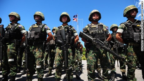 Thais are voting on whether to approve a new constitution that favors the country's military.