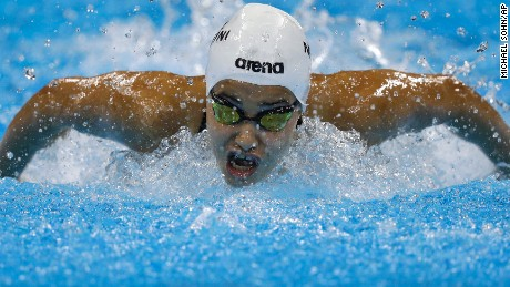Yusra Mardini, swimming for the Refugee Olympic Team, competes in a women's 100m butterfly heat during the swimming competitions at the 2016 Summer Olympics, Saturday, Aug. 6, 2016, in Rio de Janeiro, Brazil. (AP Photo/Michael Sohn)