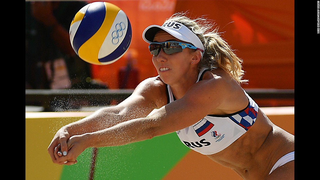 Russia's Evgenia Ukolova dives for the ball during a women's beach volleyball qualifying match against Brazil.