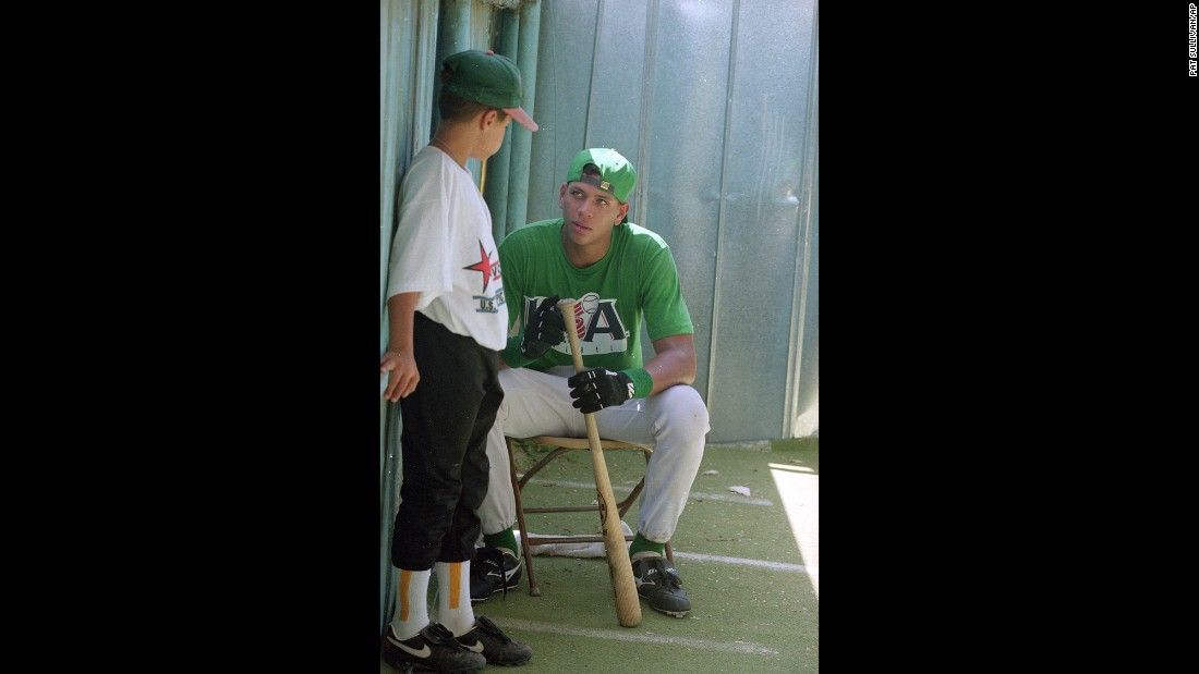 Rodriguez, shown here as a teenager in 1993, talks with 11-year-old John Santos Griffith during practice for the U.S. Olympic Festival Competition in San Antonio, Texas.