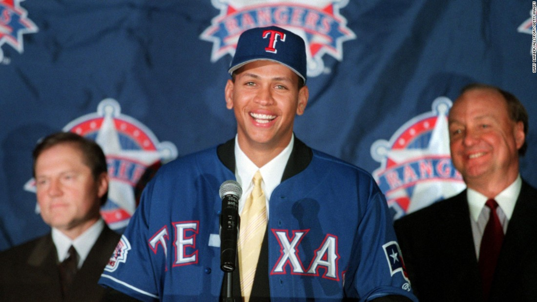 Alex Rodriguez speaks to the media after being signed to the Texas Rangers on December 12, 2000 at the Ballpark in Arlington, Texas.