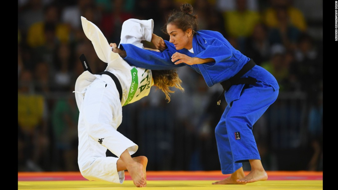 "Majlinda Kelmendi of Kosovo (blue) competes with Odette Giuffrida of Italy during the women's 52 kg judo gold medal final. Kelmendi <a href=""http://cnn.com/2016/08/07/sport/majlinda-kelmendi-kosovo-olympics/index.html"" target=""_blank"">won Kosovo's first ever Olympic medal.</a>"