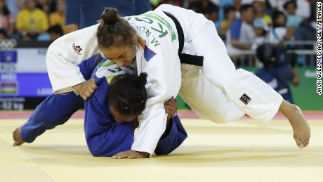 Kosovo's Majlinda Kelmendi (white) competes with Mauritius' Christianne Legentil during their women's -52kg judo contest quarterfinal match of the Rio 2016 Olympic Games in Rio de Janeiro on August 7, 2016. / AFP / Jack GUEZ        (Photo credit should read JACK GUEZ/AFP/Getty Images)