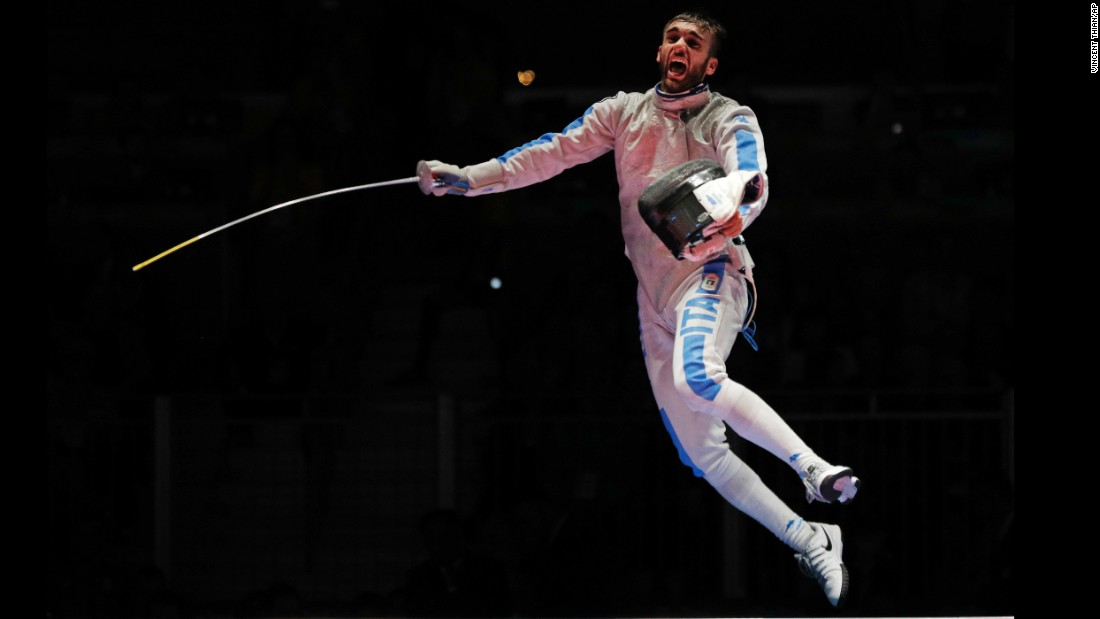 Daniele Garozzo of Italy celebrates after defeating Alexander Massialas of the United States, winning the gold medal at the men's individual foil fencing event.