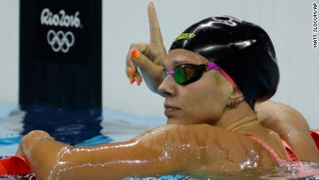 Yulia Efimova celebrates winning her heat in the women's 100-meter breaststroke, much to American Lilly King's chagrin.
