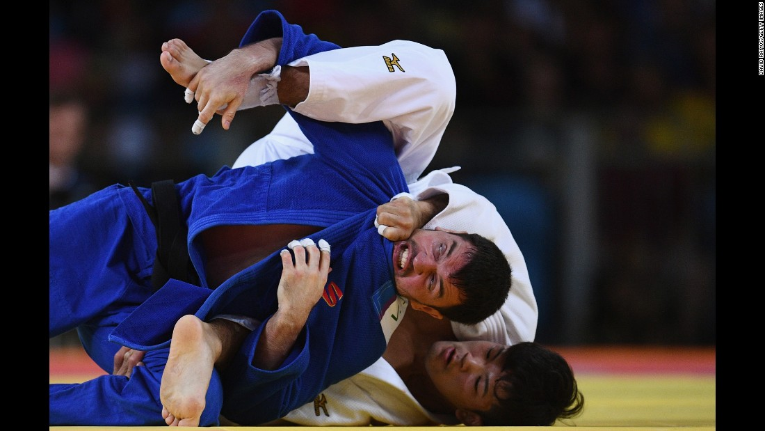 Japanese judoka Shohei Ono, in white,  competes against Victor Scvortov of the United Arab Emirates. Ono went on to win gold in the 73-kilogram weight class.