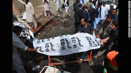 Pakistani volunteers use a trolley to move the body of a lawyer after a bomb explosion at a government hospital premises in Quetta on August 8, 2016.At least 20 people have been killed after a bomb went off at a major hospital in the southwest Pakistani city of Quetta, an AFP reporter and officials said, with fears the death toll could rise. / AFP PHOTO / BANARAS KHANBANARAS KHAN/AFP/Getty Images