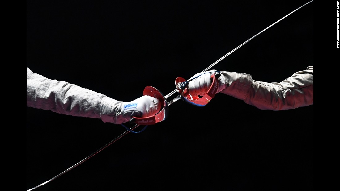 Russian fencer Sofya Velikaya, left, competes against France's Manon Brunet during a sabre semifinal bout. Velikaya defeated Brunet but lost in the final to her Russian compatriot Yana Egorian.