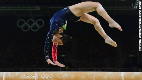 Aly Raisman nails the balancing beam during the women's team all-around preliminaries.