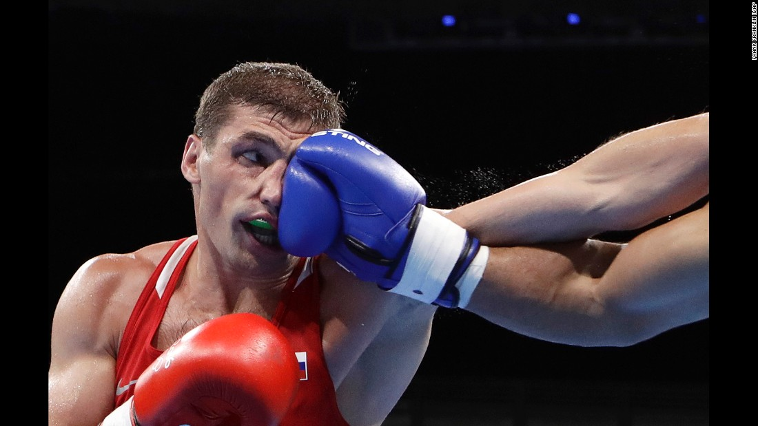 Petr Khamukov, a light-heavyweight boxer from Russia, is punched by Venezuela's Albert Ramirez during a preliminary match on Sunday, August 7. Ramirez won the bout to advance to the round of 16.