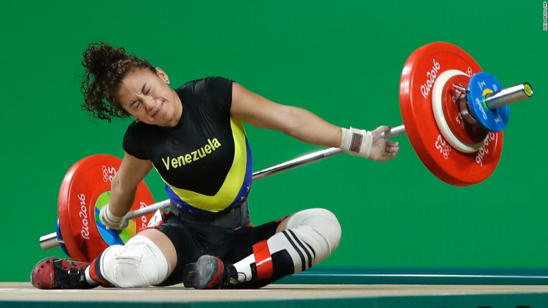 Venezuelan weightlifter Yusleidy Figueroa falls as she competes in the 58-kilogram weight class.