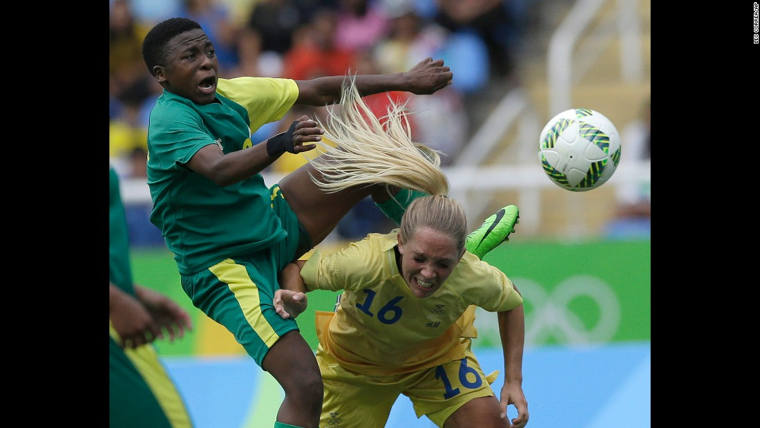 South Africa's Nothando Vilakazi, left, competes with Sweden's Elin Rubensson during the opening soccer match on Wednesday, August 3. Sweden won 1-0.
