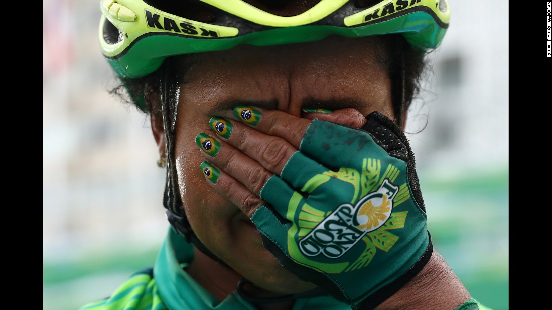 Brazilian cyclist Clemilda Fernandes reacts after finishing the women's road race on Sunday, August 7.