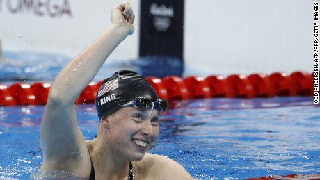 USA's Lilly King celebrates after she broke the Olympic record to win the Women's 100m Breaststroke Final during the swimming event at the Rio 2016 Olympic Games at the Olympic Aquatics Stadium in Rio de Janeiro on August 8, 2016.   / AFP / Odd Andersen        (Photo credit should read ODD ANDERSEN/AFP/Getty Images)
