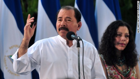 Nicaraguan President, Daniel Ortega (L), accompanied by his wife Rosario Murillo, delivers a speech after voting during municipal elections in Managua on November 4, 2012. Nicaraguans vote to elect 153 municipal mayors, 153 vice-mayors and 6076 councilors.  AFP PHOTO/Hector RETAMAL        (Photo credit should read HECTOR RETAMAL/AFP/Getty Images)