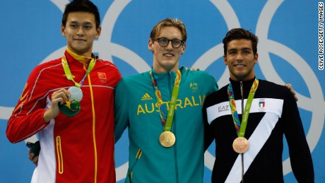 Gold medalist Mack Horton (center) accused silver medalist Yang Sun (left) of being a drug cheat.