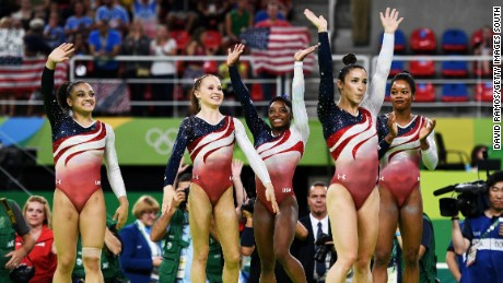 Team USA's Lauren Hernandez, Madison Kocian, Simone Biles, Alexandra Raisman and Gabrielle Douglas wave to the crowd.