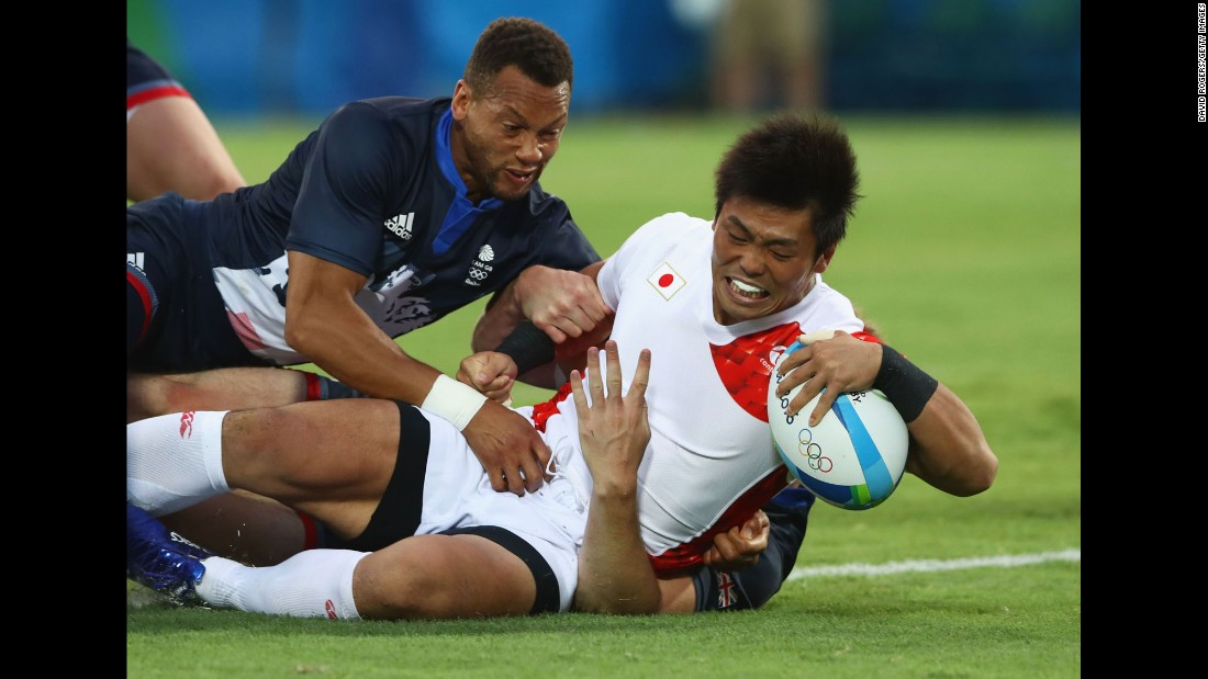 Japanese rugby player Katsuyuki Sakai scores a try against Great Britain.