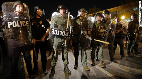 FILE - In this April 29, 2015 file photo, police stand in formation as a curfew approaches in Baltimore. In the wake of the Freddie Gray case, the police union has push back against reforms designed to provide citizens with more oversight, the union also has sued to block a civilian review board from having access to police disciplinary records.