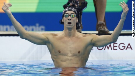 USA's Michael Phelps celebrates after he won the Men's 200m Butterfly Final during the swimming event at the Rio 2016 Olympic Games at the Olympic Aquatics Stadium in Rio de Janeiro on August 9, 2016.   / AFP / Odd Andersen        (Photo credit should read ODD ANDERSEN/AFP/Getty Images)