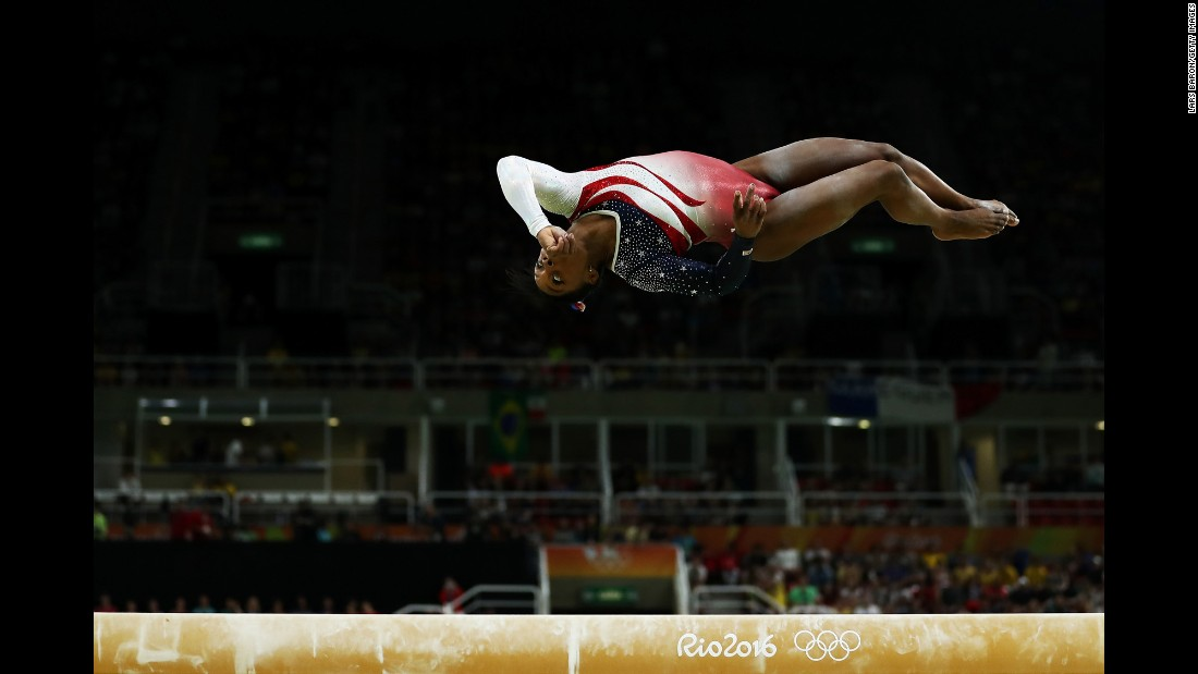 Experts call it the hardest balance beam dismount in gymnastics. Biles flips backward head-over-heels twice toward the end of the beam. Then she jumps backward off the end of the beam, flipping in mid-air twice before sticking the landing perfectly.