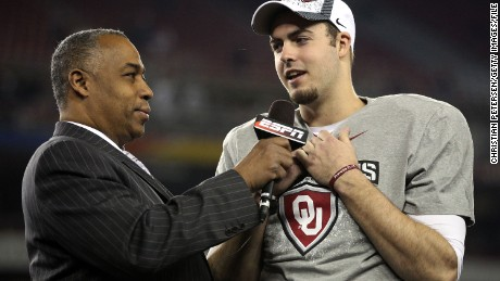 GLENDALE, AZ - JANUARY 01:  Quarterback Landry Jones #12 of the Oklahoma Sooners and offensive MVP is interviewed by ESPN's John Saunders after the Sooners 48-20 victory against the Connecticut Huskies during the Tostitos Fiesta Bowl at the Universtity of Phoenix Stadium on January 1, 2011 in Glendale, Arizona.  (Photo by Christian Petersen/Getty Images)
