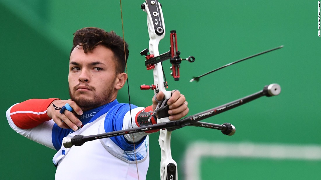 Italy's David Pasqualucci shoots an arrow during the individual archery competition.