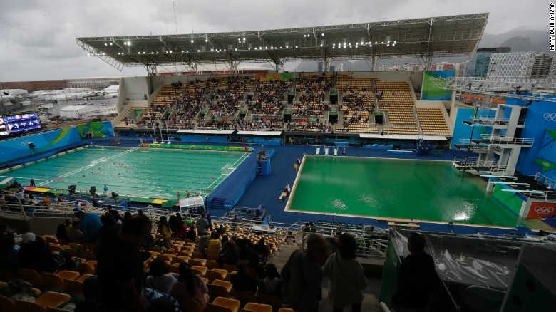 the water of the diving pool at right appears a murky green as the water polo - Olympic Swimming Pool 2016