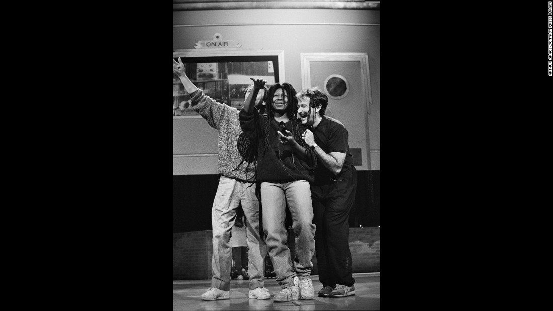 Williams rehearses a dance number with Billy Crystal and Whoopi Goldberg for Comic Relief in 1990.