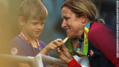 Kristin Armstrong celebrates with her 5-year-old son Lucas after winning gold.