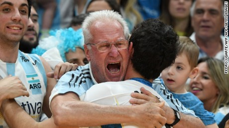 Argentinian volleyballer Demian Gonzalez is hugged by a fan after his team won the men's qualifying volleyball match between Russia and Argentina at the Maracanazinho stadium in Rio de Janeiro.