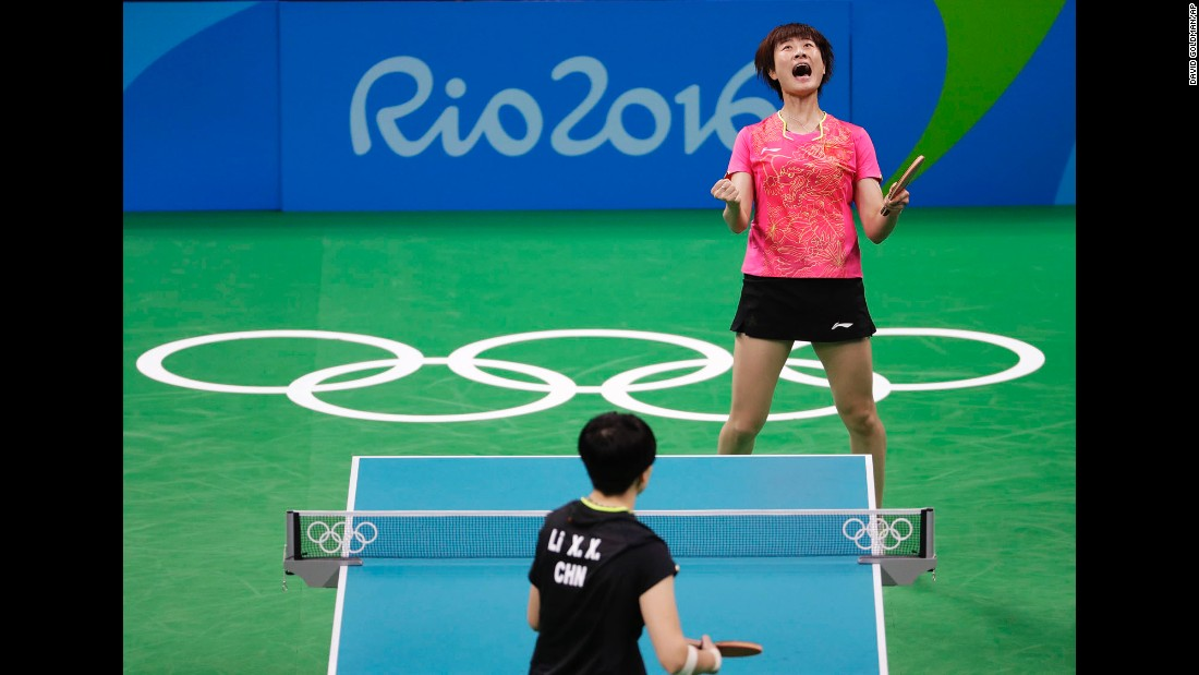 China's Ding Ning, top, reacts after defeating her compatriot Li Xiaoxia to win table tennis gold.