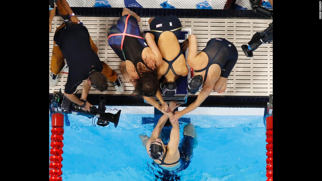 Katie Ledecky is congratulated by her U.S. teammates Allison Schmitt, Leah Smith and Emily DiRado after swimming the anchor leg of the 4x200 freestyle on Wednesday, August 10. The gold medal is Ledecky's third of the Rio Games.