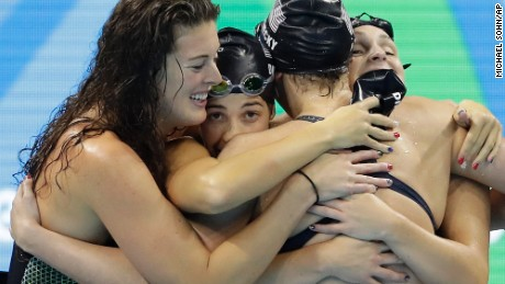 United States' Katie Ledecky, second from right, celebrates with her teammates Allison Schmitt, Maya DiRado and Leah Smith, from left, after coming first in the women's 4 x 200-meter freestyle relay final during the swimming competitions at the 2016 Summer Olympics, Thursday, Aug. 11, 2016, in Rio de Janeiro, Brazil. (AP Photo/Michael Sohn)