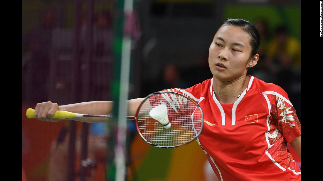 Chinese badminton player Wang Yihan returns a shot during a singles match against Ireland's Chloe Noelle Magee.