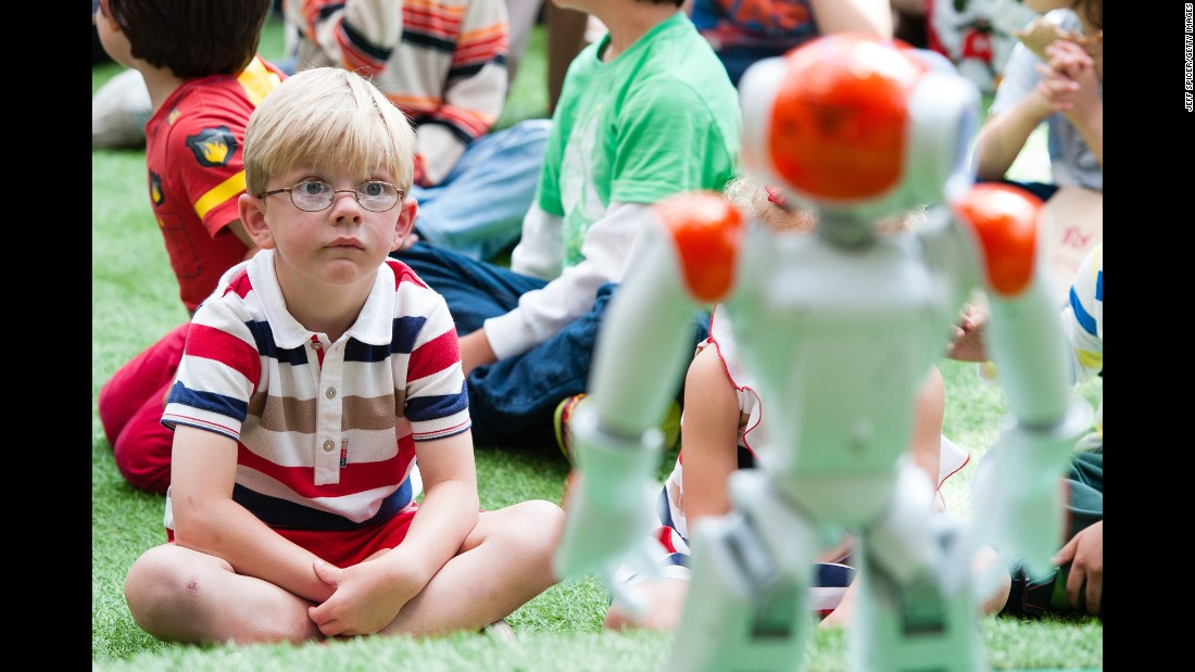Alexander the friendly robot interacts with children in London on Wednesday, August 10.