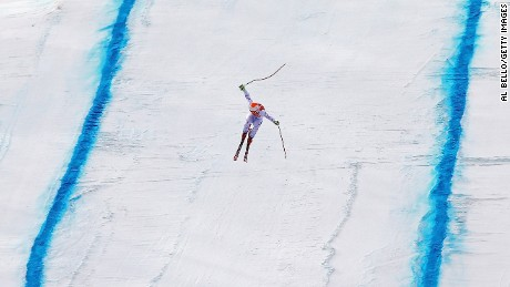 "U.S. skier Travis Ganong competes in the downhill during the 2014 Winter Games in Sochi, Russia. ""You've got to put on skis, get up on the mountain with the other Olympic athletes and ski the same mountain as them,"" Bello said."