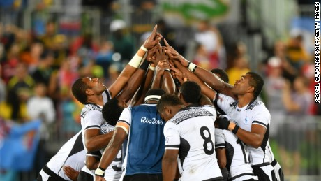 Fiji's players pray after victory in the men's rugby sevens gold medal match.