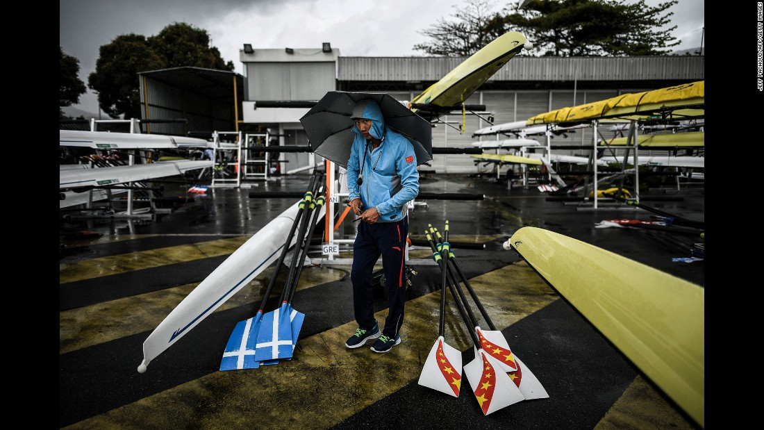A rower prepares boats for a training session.
