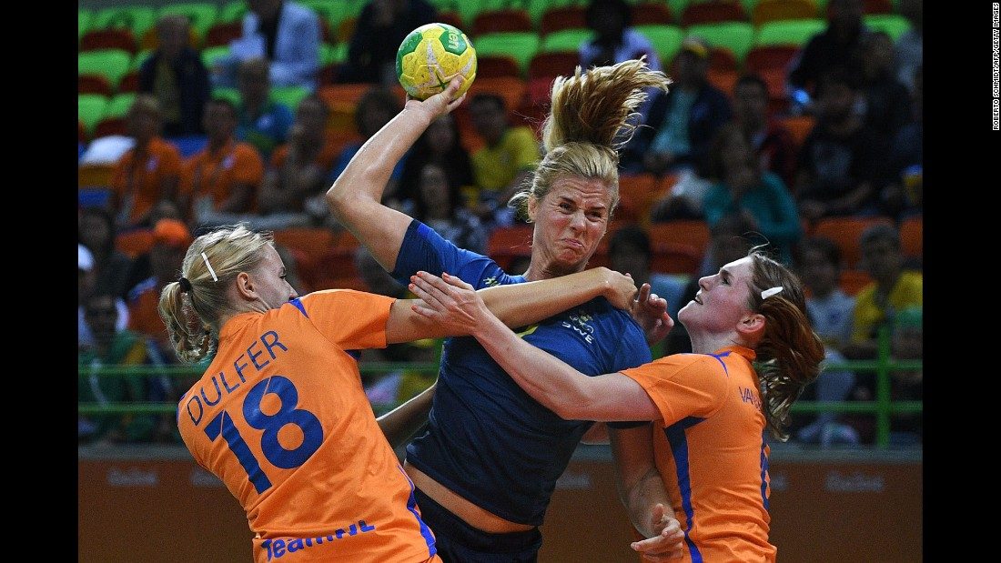 Sweden's Linnea Torstensson, center, competes against the Netherlands' Kelly Dulfer and Laura van der Heijden during a preliminary handball match.