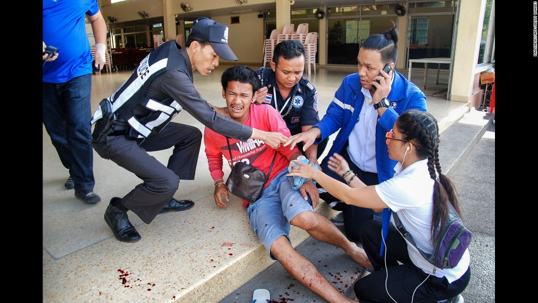 A victim is treated for injuries at the site of a bomb explosion in Hua Hin on Friday, August 12. No one has claimed responsibility for the blasts but Thai police say there's no evidence the attacks are related to international terrorism.