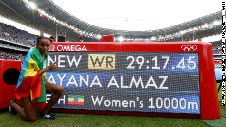 Ethiopia's Almaz Ayana celebrates winning the women's 10,000m final.