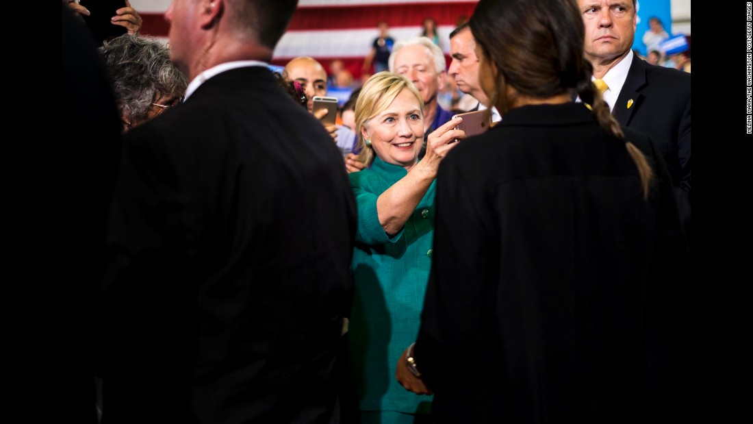 Hillary Clinton takes photos and meets voters during a campaign rally in Des Moines, Iowa, on Wednesday, August 10.