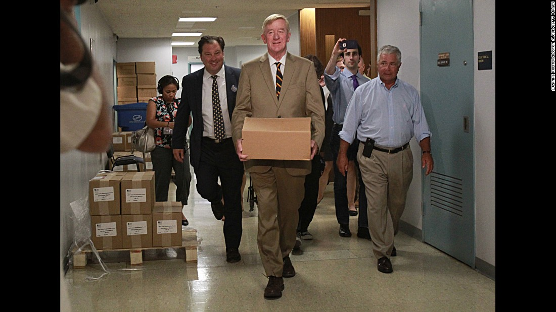 Former Massachusetts Gov. William Weld, the Libertarian Party's vice presidential nominee, delivers petitions Monday, August 8, to get the Libertarian ticket on the Massachusetts ballot in November.