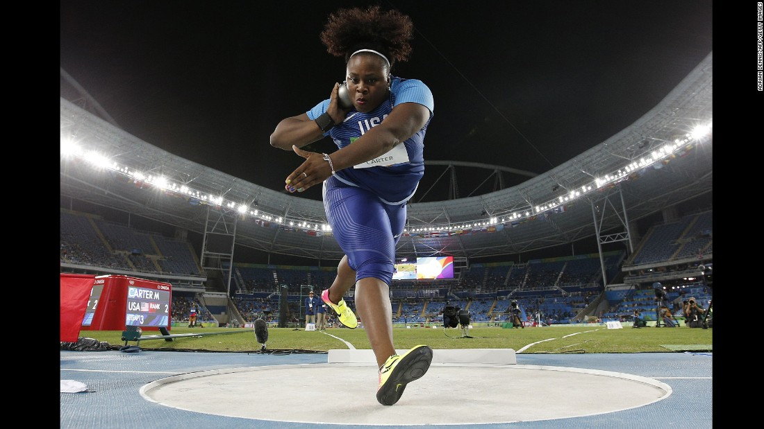 U.S. athlete Michelle Carter competes in the shot put final. She won gold with a throw of 20.63 meters, becoming the first American woman ever to win the event. Carter's father, former NFL player Michael Carter, won Olympic silver in the shot put in 1984.