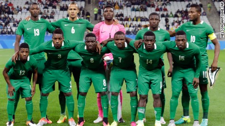 The Nigerian team poses for photos before a match of the men's Olympic football tournament between Colombia and Nigeria in Sao Paulo, Brazil, on Wednesday, August 10, 2016.